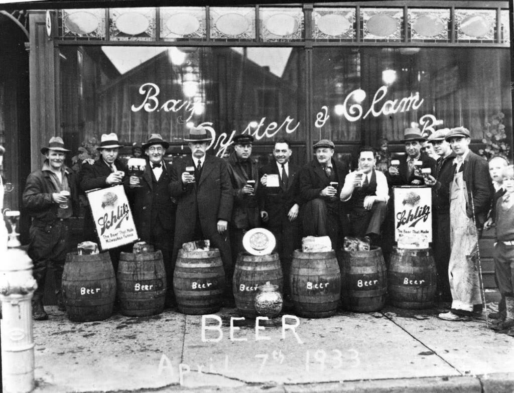 Vintage Photo of men standing outside of Claudio's Restaurant